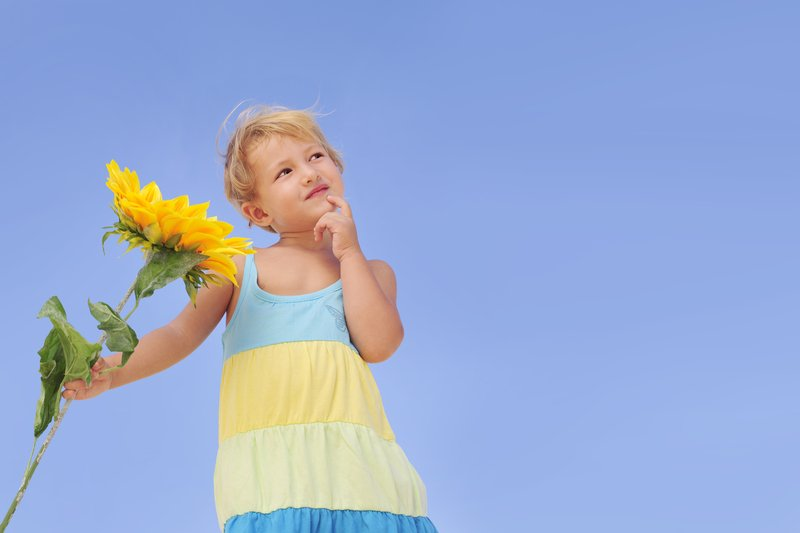 little girl wondering what is a sunflower